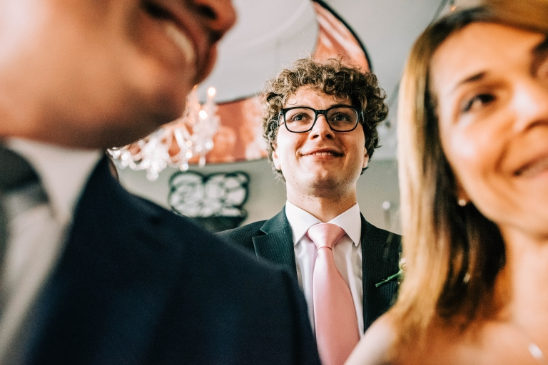 Brides brother watches the happy couple's first dance