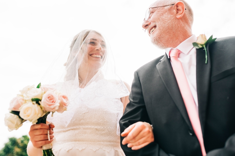 Bride gets shares a joke with her father