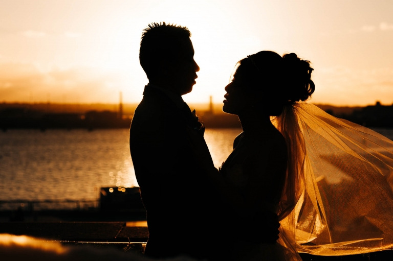 Bride and groom silhouette on rooftop of Liver building