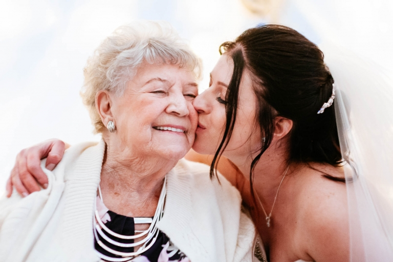 Bride gives her grandmother a big kiss