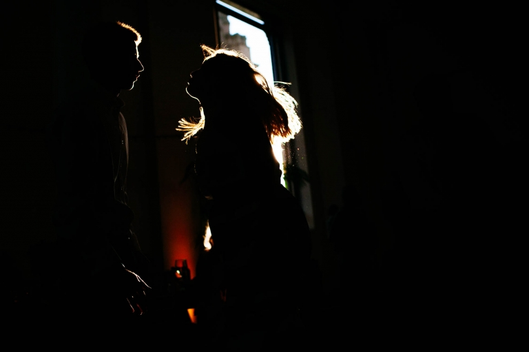 Wedding guests dancing in silhouette
