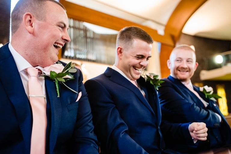 Groom shares a joke with his best men