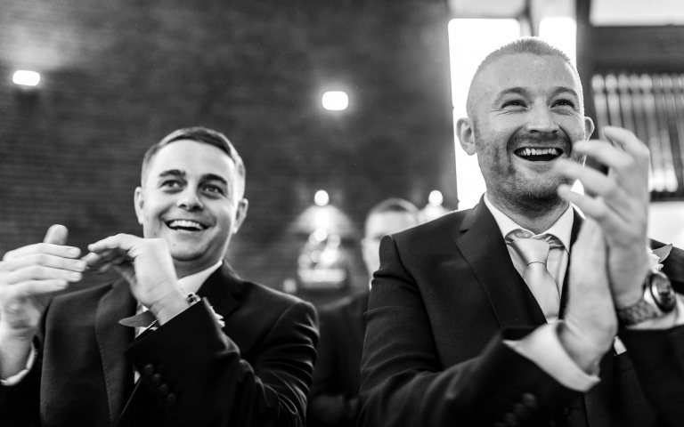 Best men congratulate the happy couple