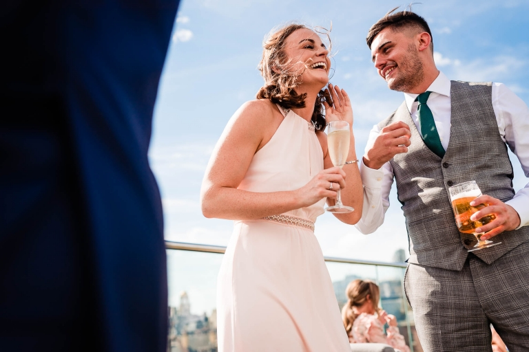 Bridesmaid and her brother sharing a joke