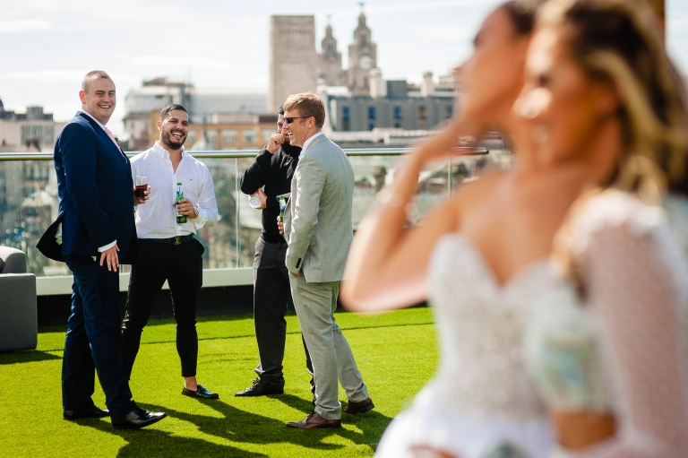Groom shares a joke with guests