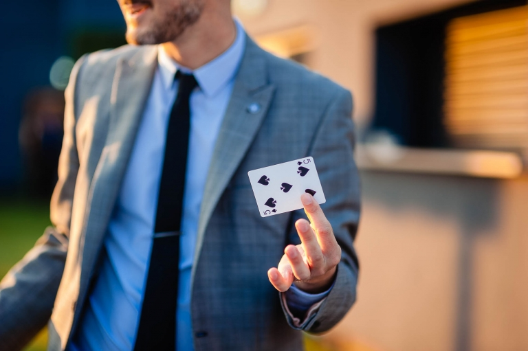 Magician shows a playing card