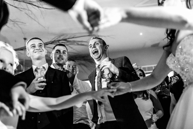 Guests cheer the bride and groom during the first dance