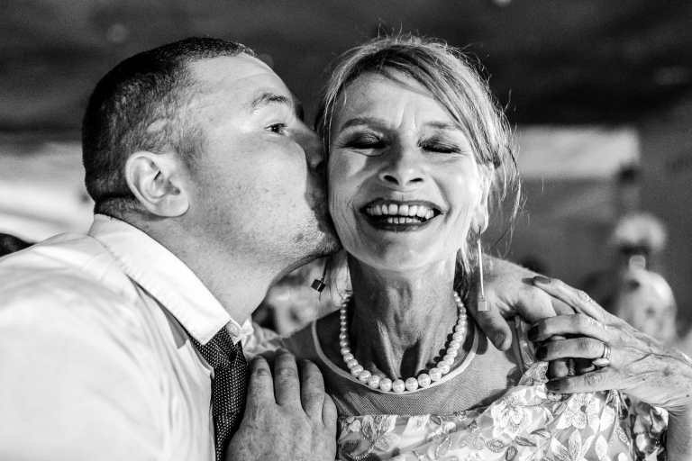 Mother of the groom gets a kiss on the cheek