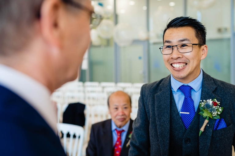 Groom chats with wedding celebrant