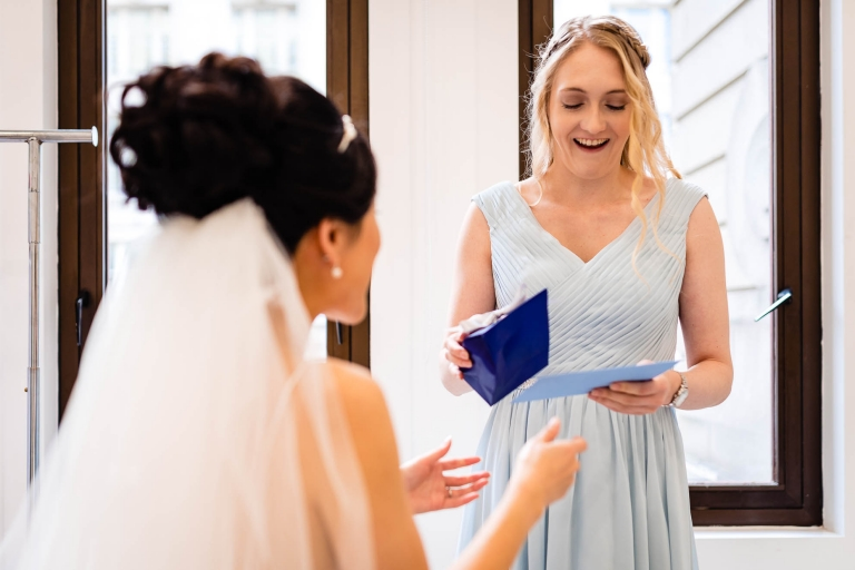 Bridesmaid smiles at her present