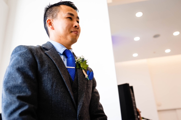 Groom looks at his bride as she walks up the aisle