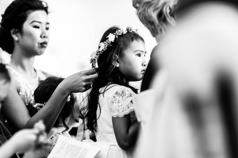 Flower girl watches the ceremony