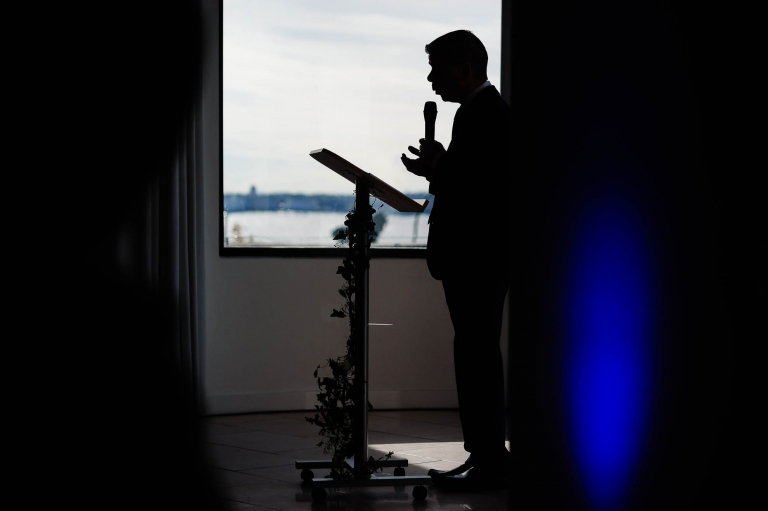 Silhouette of wedding celebrant during the ceremony