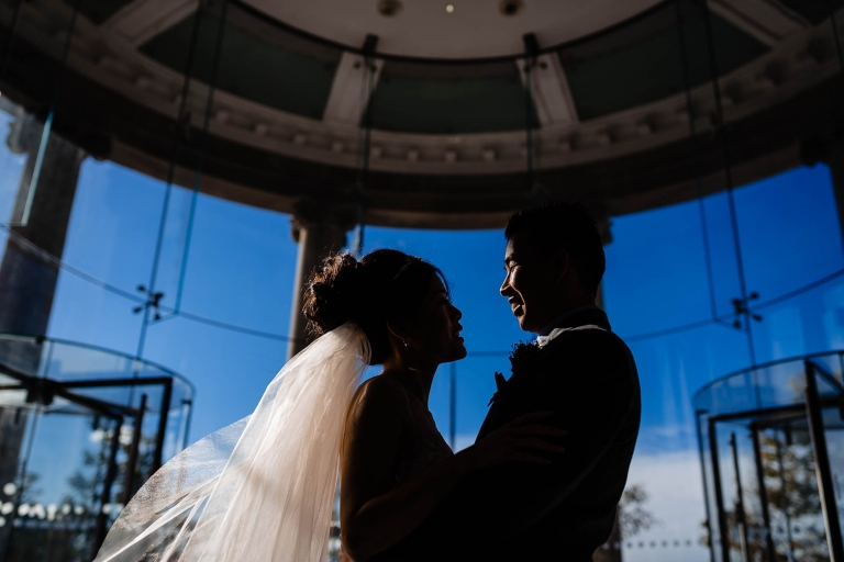 Bride and groom close up portrait in silhouette