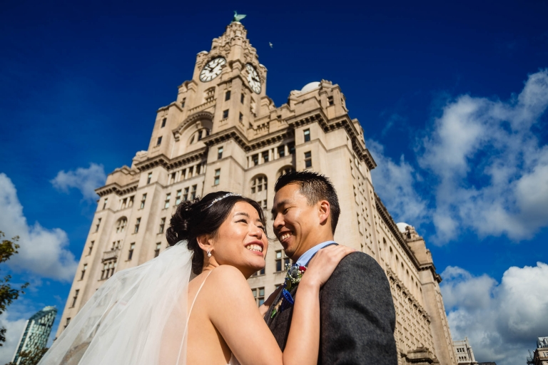 Bride and groom outside the Liver Building