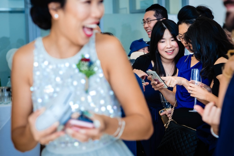 Guests amused at a mobile phone
