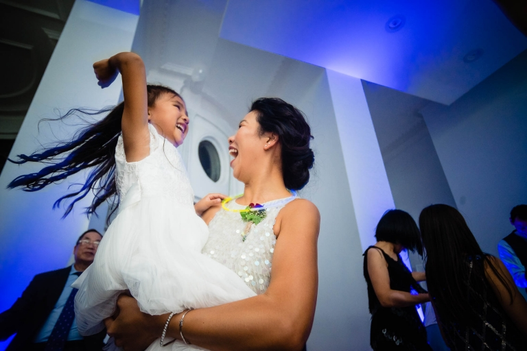 Flower girl dancing with her aunt