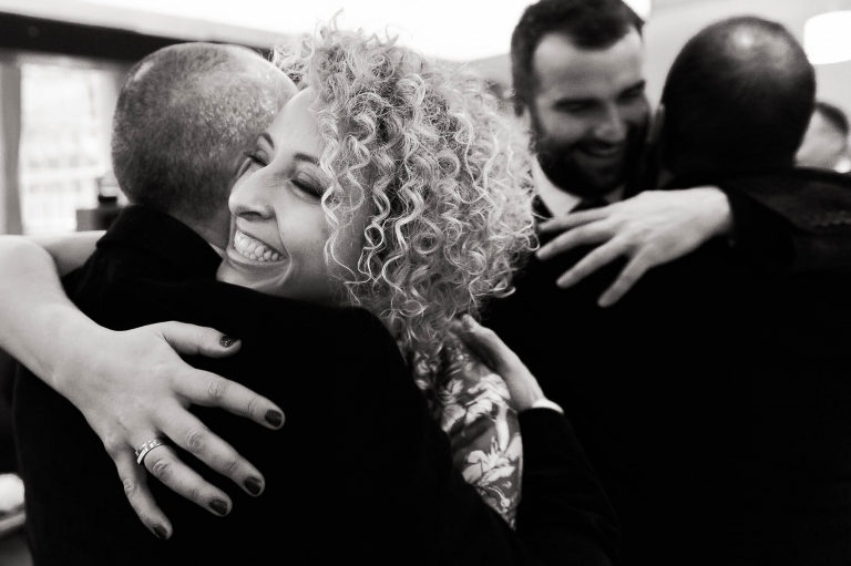 Guest hugs the groom