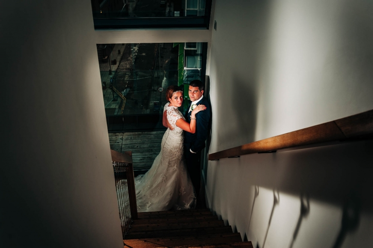 Bride and groom portrait on staircase of Hope Street hotel