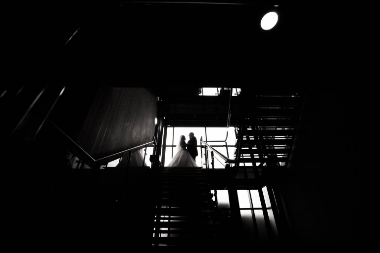Bride and groom silhouette on staircase