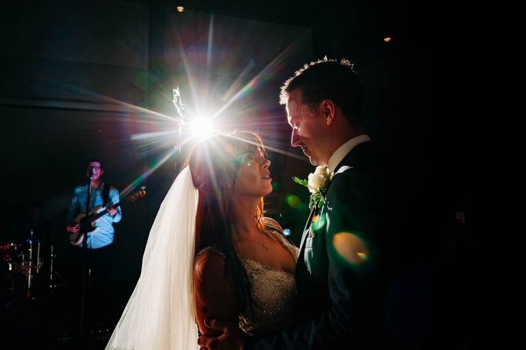 Bride and groom smile during first dance