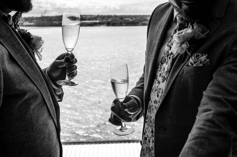The happy couple enjoy a glass of champagne