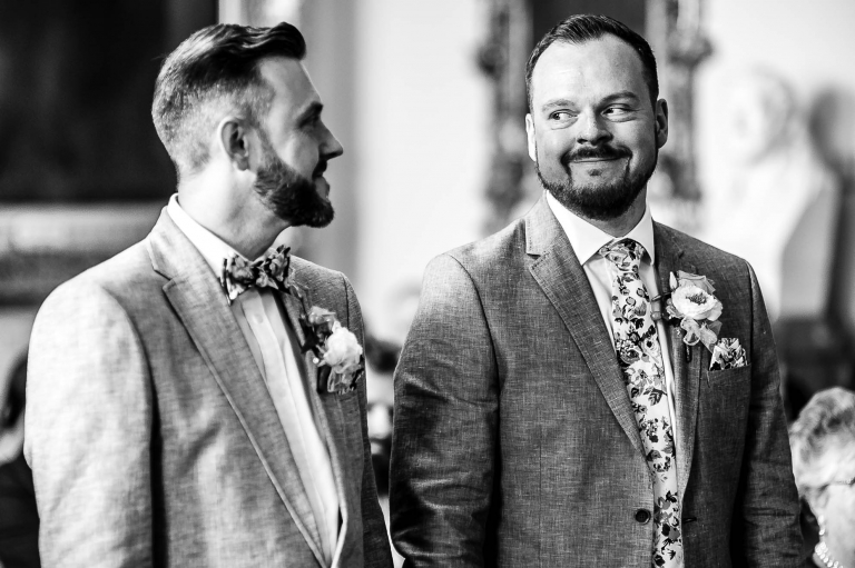 The couple smile at each other during the wedding ceremony