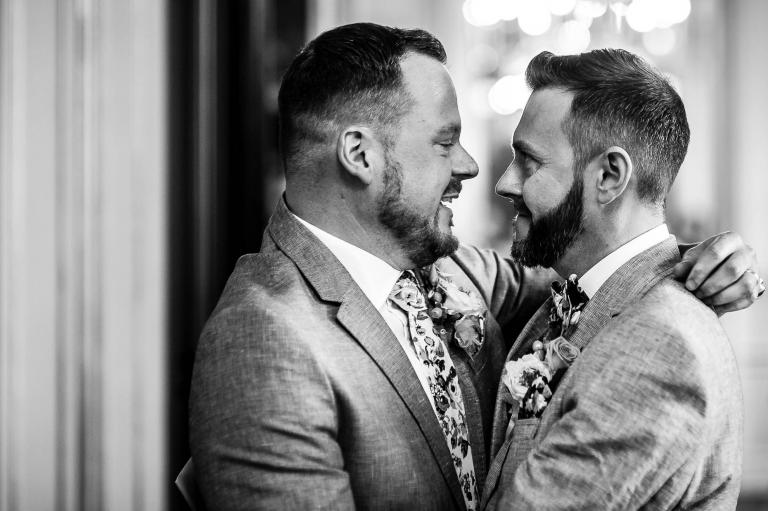 Newlyweds hug after wedding ceremony