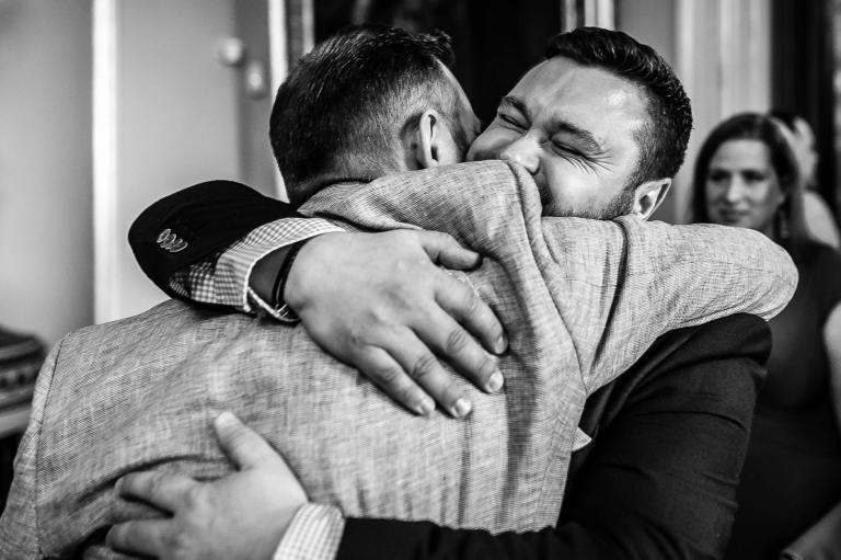 groom hugs guest