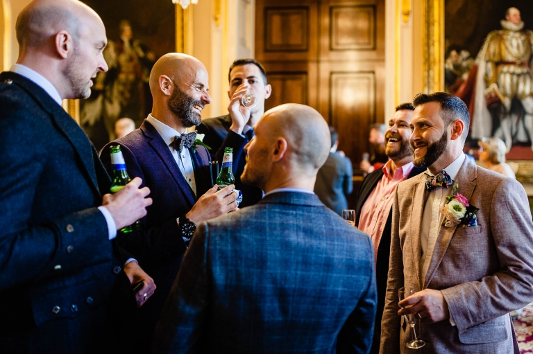 Groom share a joke with guests
