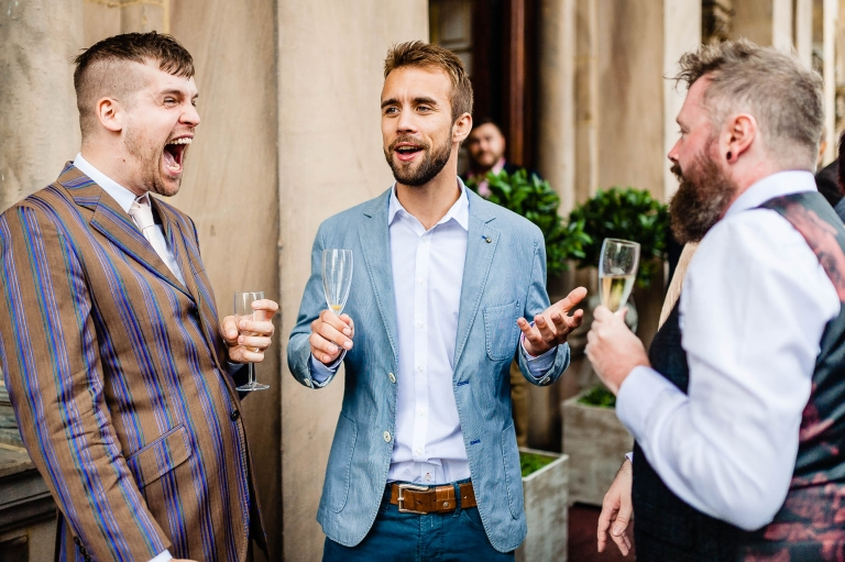 Guest laughing at a joke with friends