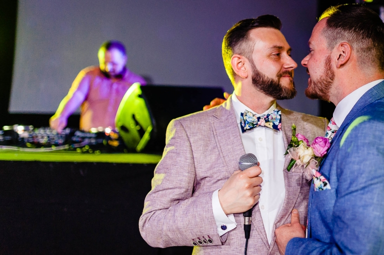 newlyweds stare into each others eyes during speeches