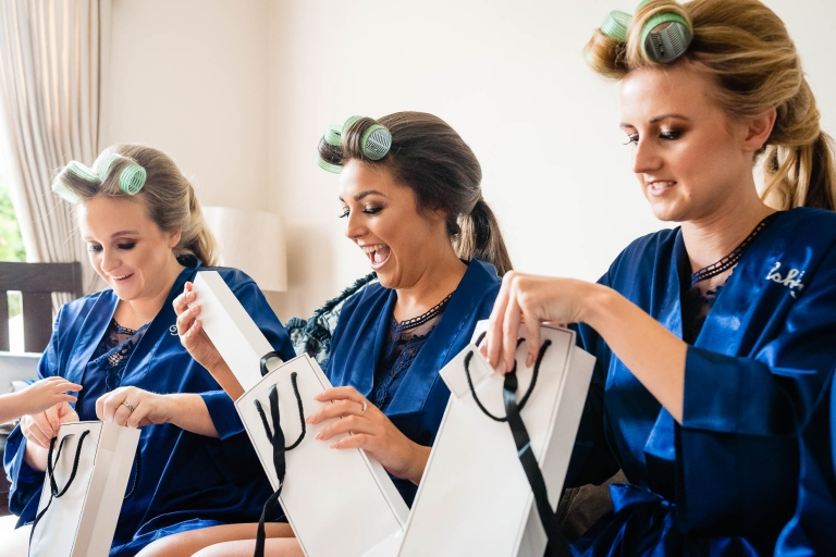 Bridesmaids get excited as they open their presents