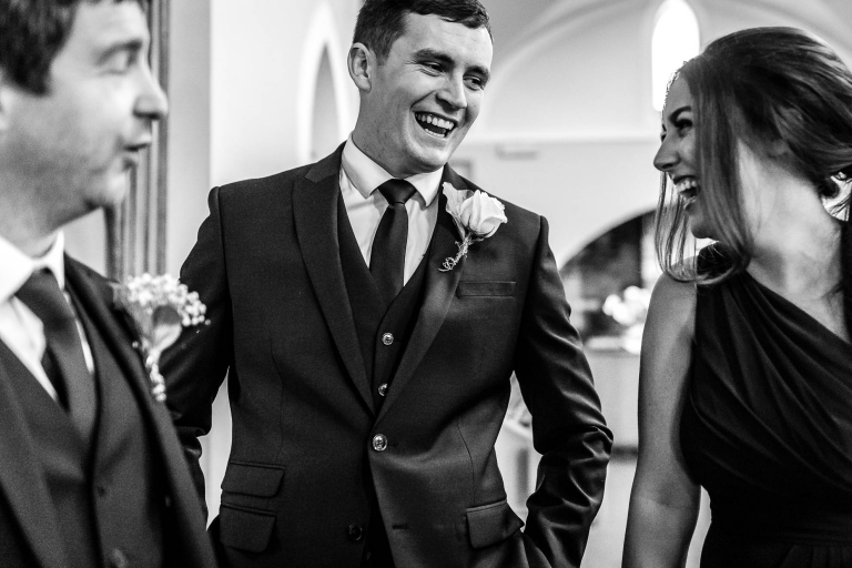 Usher and bridesmaid share a joke