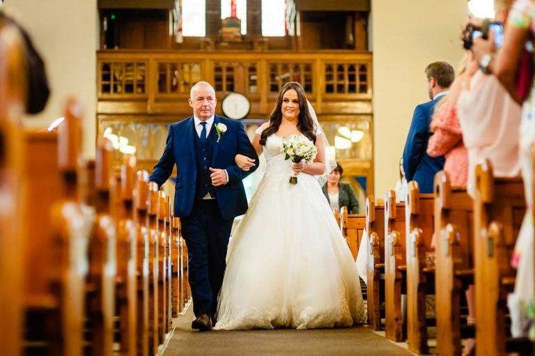 Bride walks up the ailse