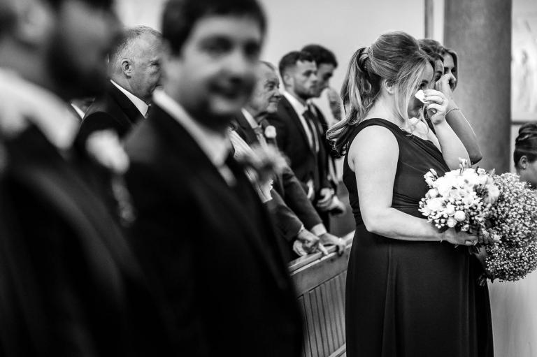 brides sister wipes away a tear