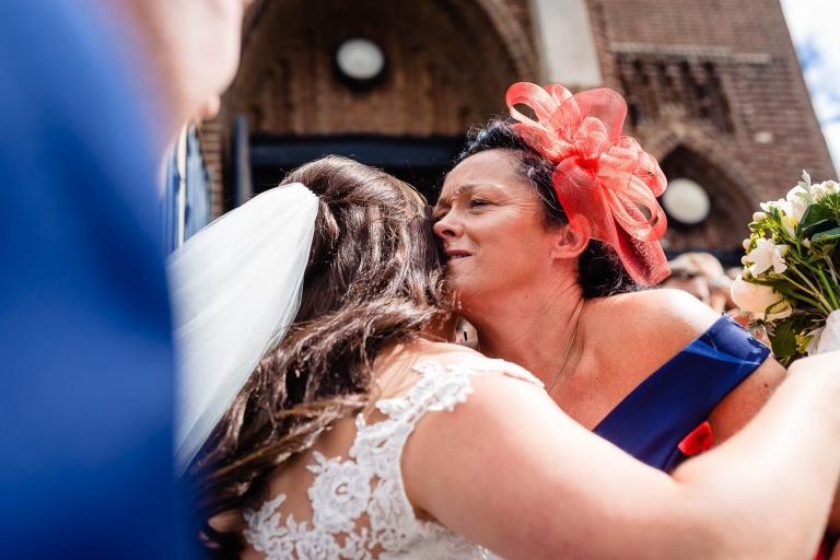 Guest gives bride a hug