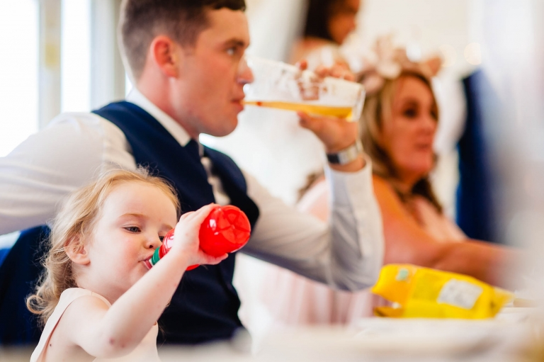Little girl and her dad having a drink