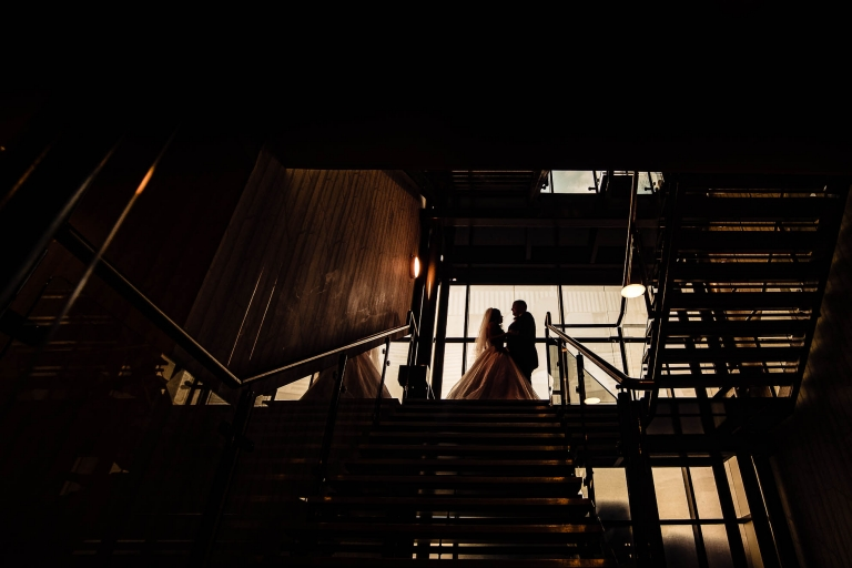 Silhouette of couple on stairs