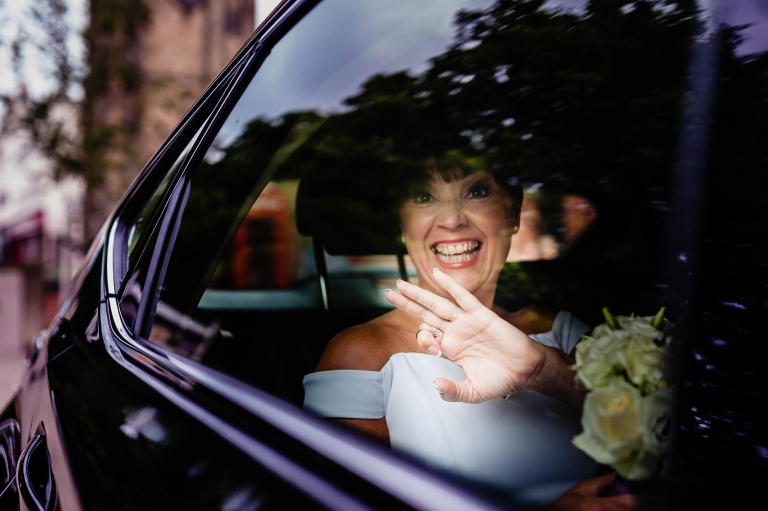 Bride arrives at wedding ceremony in wedding car