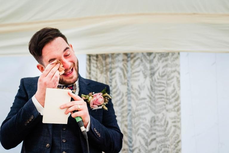 Groom sheds a tear as he gives his speech