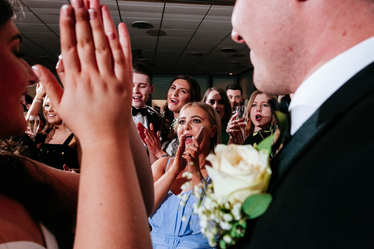 wedding guests applaud bride and groom after first dance