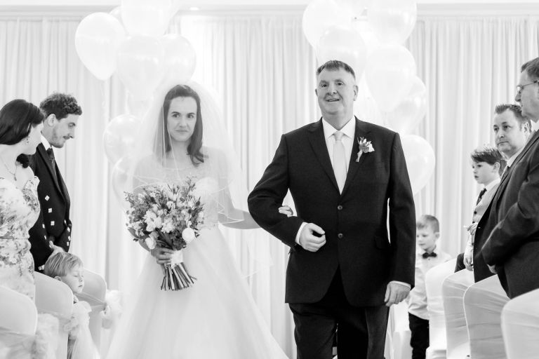 Bride walks up the aisle with her father