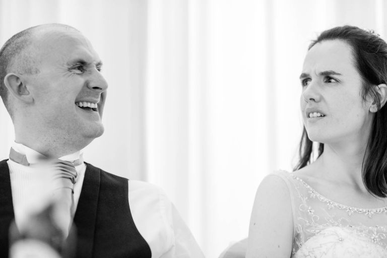 Groom laughs during best man's speech