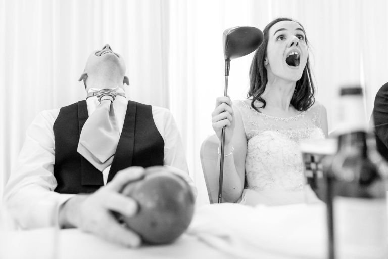 Bride and groom laugh at best mans joke