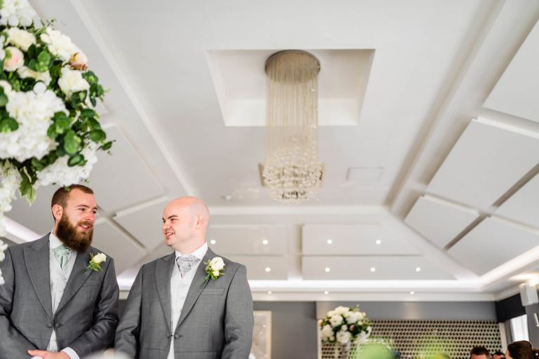 Groom waits for his bride with his best man