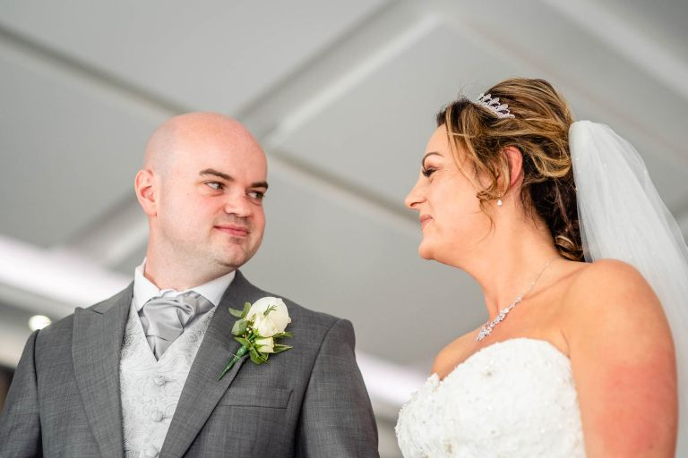 Bride and groom share a meaningful glance