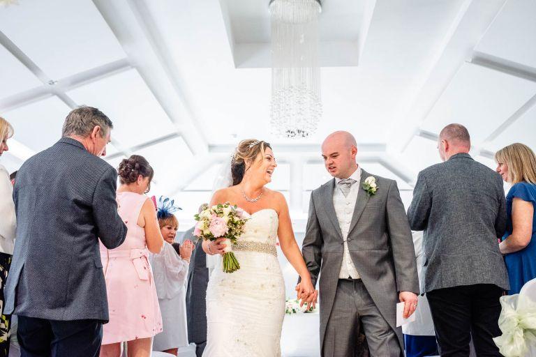 Newlyweds walk back down aisle