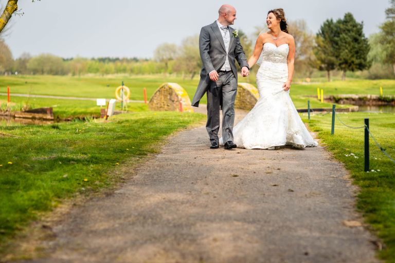 Bride and groom walking together and laughing