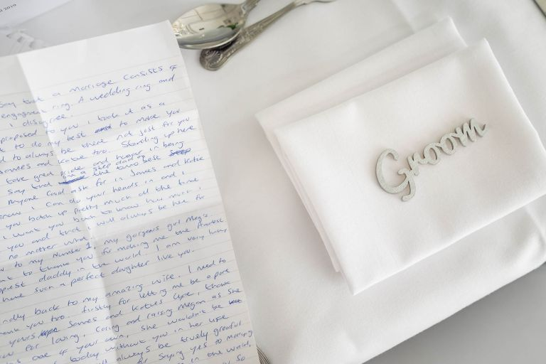 Grooms place setting with his speech notes